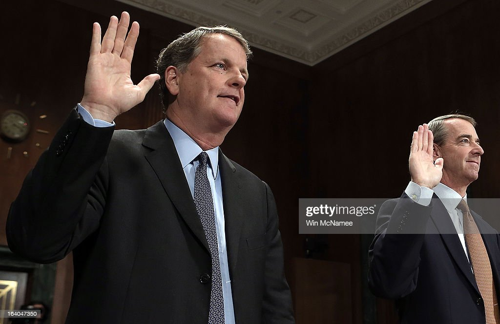 Douglas Parker (L), chairman and CEO of the US Airways Group, and Thomas Horton, chairman of the president and CEO of American Airlines, are sworn in during a hearing of the Senate Judiciary Committee on Capitol Hill March 19, 2013 in Washington, DC. Parker and Horton testified before the committee on the topic of 'The American Airlines/US Airways Merger: Consolidation, Competition, and Consumers.'
