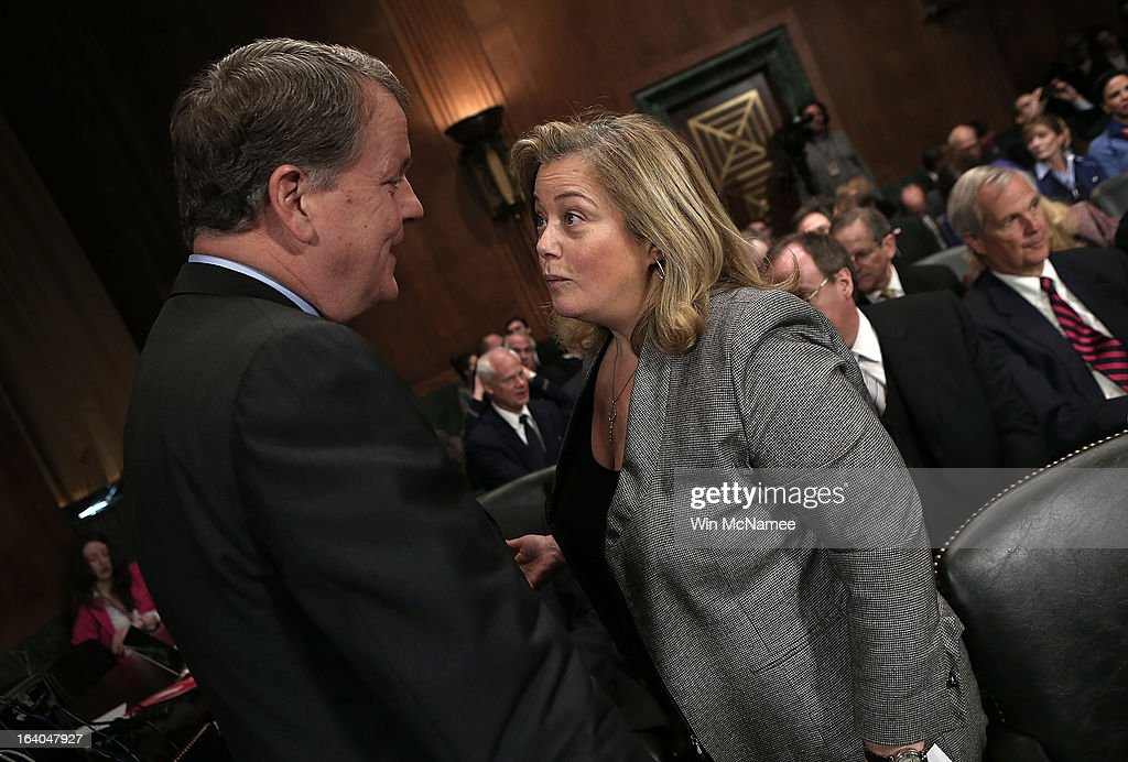 Douglas Parker (L), chairman and CEO of the US Airways Group speaks with lobbyist <a gi-track='captionPersonalityLinkClicked' href=/galleries/search?phrase=Hillary+Rosen&family=editorial&specificpeople=3335034 ng-click='$event.stopPropagation()'>Hillary Rosen</a> (R) before a hearing of the Senate Judiciary Committee on Capitol Hill March 19, 2013 in Washington, DC. Parker and Horton testified before the committee on the topic of 'The American Airlines/US Airways Merger: Consolidation, Competition, and Consumers.'