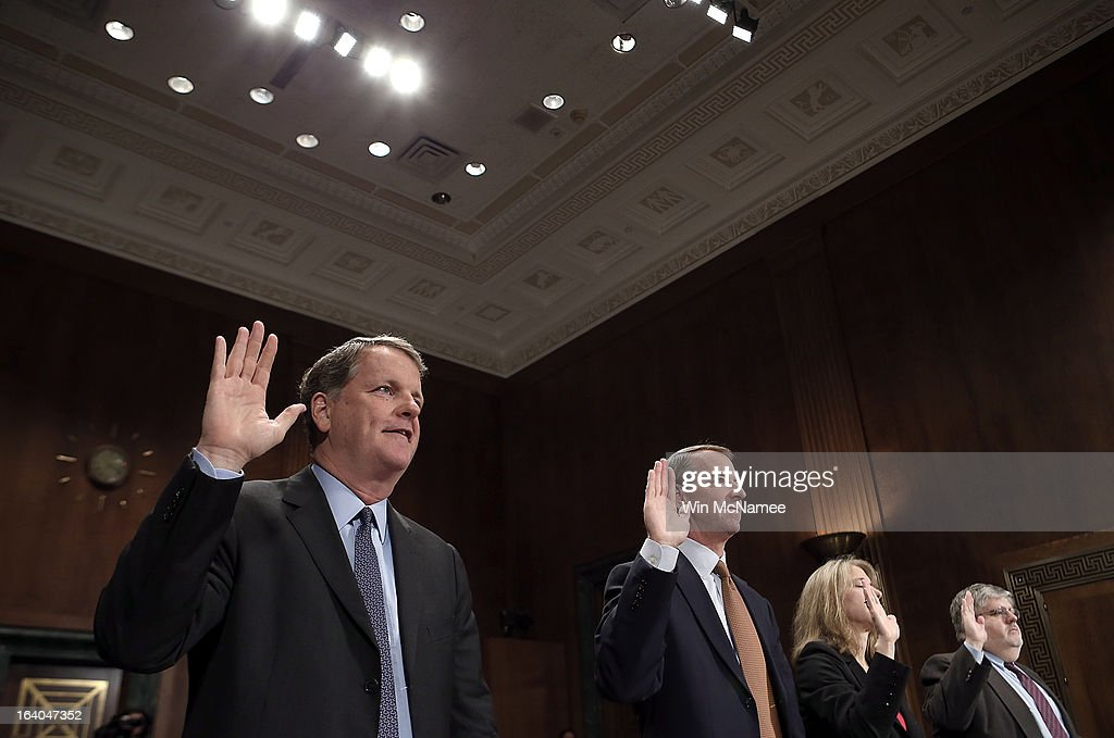 Douglas Parker, chairman and CEO of the US Airways Group; Thomas Horton, chairman of the president and CEO of American Airlines; Diana Moss, director and vice president of the American Antitrust Institute; and William McGee, consultant for the Consumers Union are sworn in during a hearing of the Senate Judiciary Committee on Capitol Hill March 19, 2013 in Washington, DC. Parker and Horton testified before the committee on the topic of 'The American Airlines/US Airways Merger: Consolidation, Competition, and Consumers.'