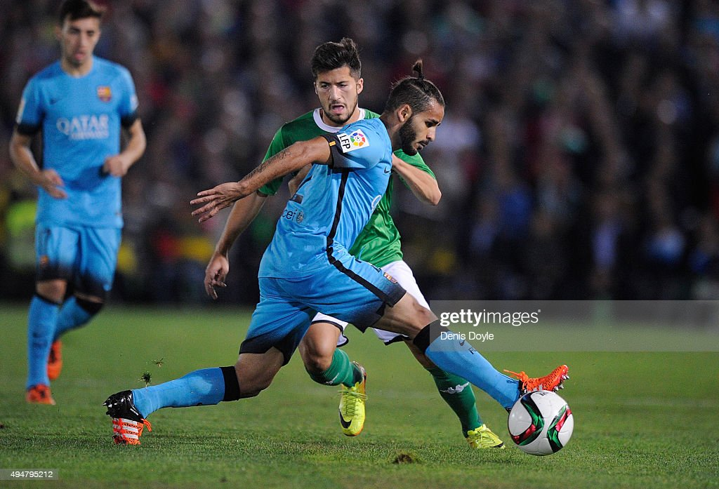 Douglas Pereira dos Santos of FC Barcelona cuts off Tapia of CF Villanovense during of the Copa del Rey Last of 16 First Leg match between CF...