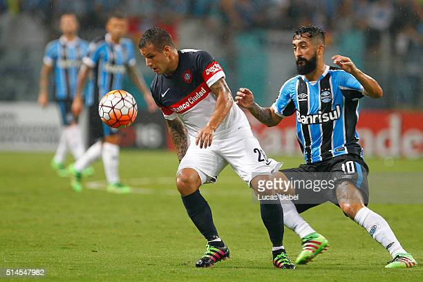 Douglas player of Gremio battles for the ball against Mauro Matos during the match Gremio v San Lorenzo as part of Copa Bridgestone Libertadores 2016...