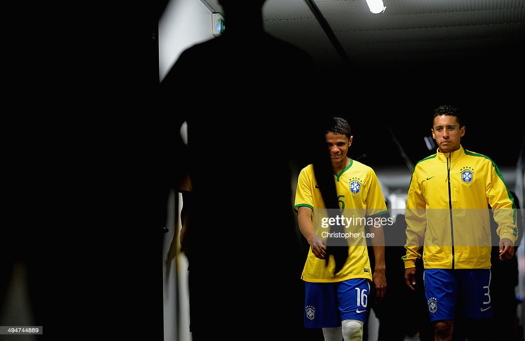 Douglas Santos and Marquinhos of Brazil walk down the tunnel for the second half during the Toulon Tournament Group B match between Brazil and Qatar at the Leo Legrange Stadium on May 30, 2014 in Toulon, France.