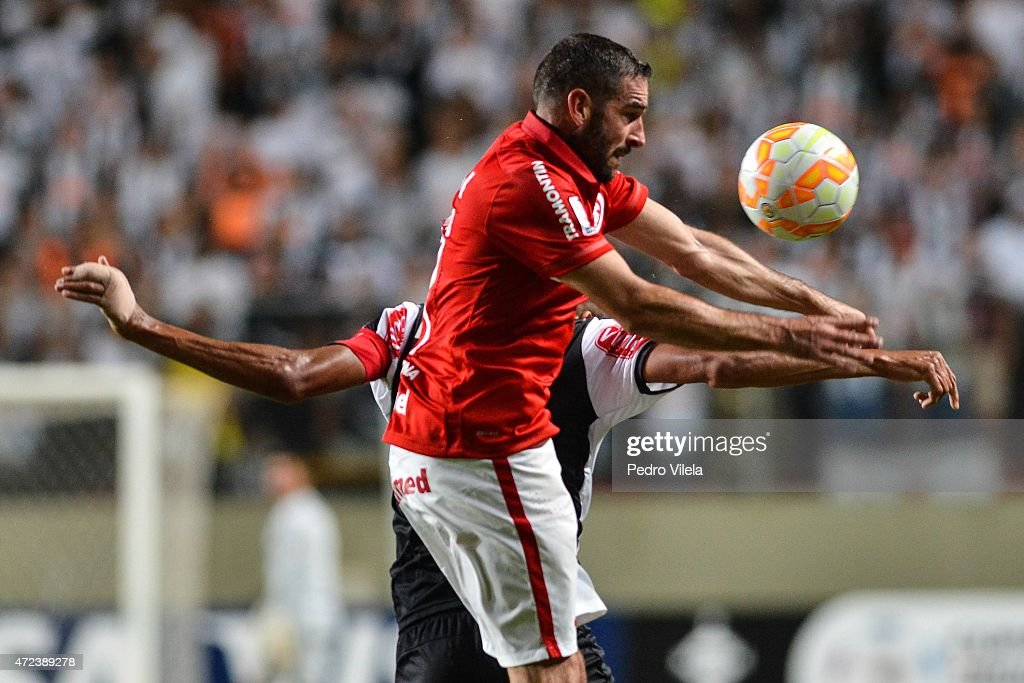 Douglas Santos #6 of Atletico MG and <a gi-track='captionPersonalityLinkClicked' href=/galleries/search?phrase=Lisandro+Lopez&family=editorial&specificpeople=801562 ng-click='$event.stopPropagation()'>Lisandro Lopez</a> #17 of Internacional battle for the ball during a match between Atletico MG and Internacional as part of Copa Bridgestone Libertadores 2015 at Independencia Stadium on May 6, 2015 in Belo Horizonte, Brazil.
