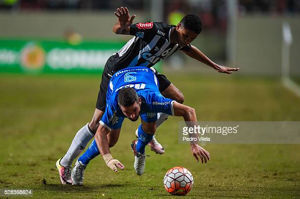 Douglas Santos of Atletico MG and Lisandro Lopez of Racing battle for the ball during a match between Atletico MG and Racing as part of Copa...
