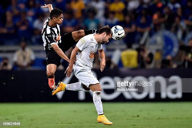 Douglas Santos of Atletico MG struggles for the ball with a Everton Ribeiro of Cruzeiro during a match between Atletico MG and Cruzeiro as part of...