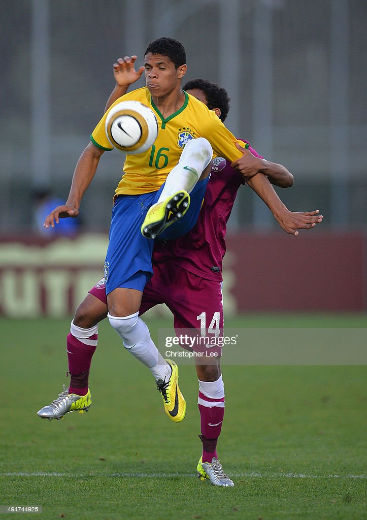 Douglas Santos of Brazil wins the ball in the air from Ahmad Al Saadi of Qatar during the Toulon Tournament Group B match between Brazil and Qatar at the Leo Legrange Stadium on May 30, 2014 in Toulon, France.
