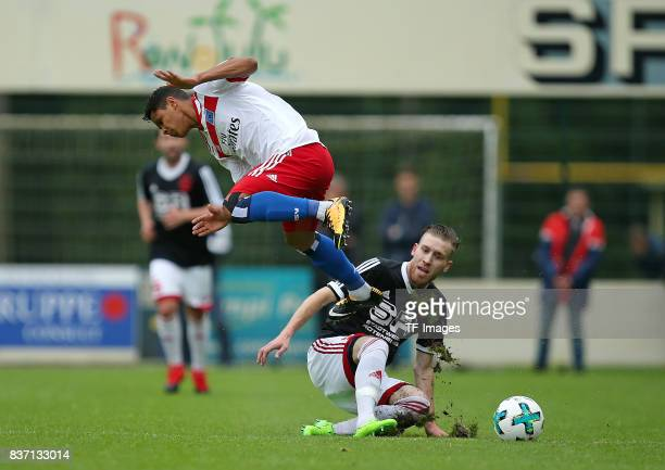 Douglas Santos of Hamburg and MarkMichael Voelker of Rotenburg battle for the balll during the preseason friendly match between Rotenburger SV and...