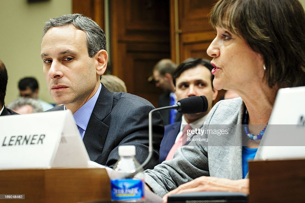 Douglas Shulman, former commissioner of the Internal Revenue Service (IRS), left, listens as Lois Lerner, the director of the IRS's exempt organizations office, speaks at a House Oversight and Government Reform Committee hearing in Washington, D.C., U.S., on Wednesday, May 22, 2013. Lerner, the mid-level IRS official at the center of a controversy over treatment of small-government groups, invoked her right not to testify after reading a statement denying that she had committed any crimes. Photographer: Pete Marovich/Bloomberg via Getty Images