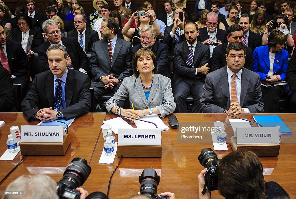 Douglas Shulman, former commissioner of the Internal Revenue Service (IRS) left, Lois Lerner, the director of the IRS's exempt organizations office, center, and Neal Wolin, deputy secretary of the U.S. Treasury, right, wait to testify at a House Oversight and Government Reform Committee hearing in Washington, D.C., U.S., on Wednesday, May 22, 2013. Lerner, the mid-level IRS official at the center of a controversy over treatment of small-government groups, invoked her right not to testify after reading a statement denying that she had committed any crimes. Photographer: Pete Marovich/Bloomberg via Getty Images
