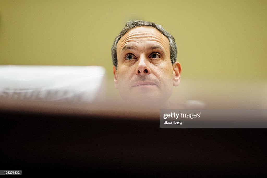 Douglas Shulman, former commissioner of the Internal Revenue Service (IRS), listens during a House Oversight and Government Reform Committee hearing in Washington, D.C., U.S., on Wednesday, May 22, 2013. Lois Lerner, the mid-level IRS official at the center of a controversy over treatment of small-government groups, invoked her right not to testify after reading a statement denying that she had committed any crimes. Photographer: Pete Marovich/Bloomberg via Getty Images