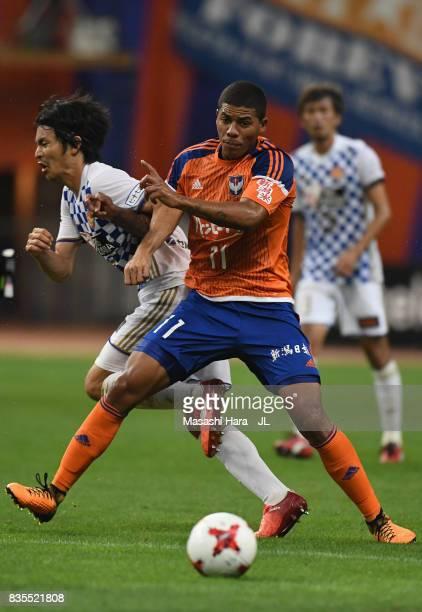 Douglas Tanque of Albirex Niigata and Kazuki Oiwa of Vegalta Sendai compete for the ball during the JLeague J1 match between Albirex Niigata and...