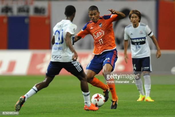 Douglas Tanque of Albirex Niigata and Martinus of Yokohama FMarinos compete for the ball during the JLeague J1 match between Albirex Niigata and...