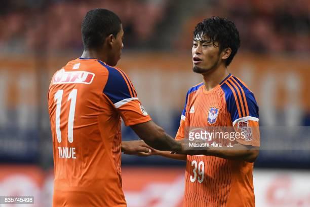 Douglas Tanque of Albirex Niigata is replaced by Takamitsu Tomiyama during the JLeague J1 match between Albirex Niigata and Vegalta Sendai at Denka...