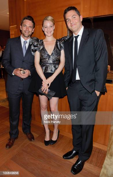 Dougray Scott Romola Garai and Ol Parker attend the launch of the Louis Vuitton Bond Street Maison on May 25 2010 in London England