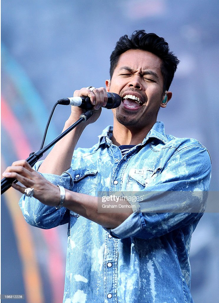 Dougy Mandagi of Temper Trap performs live on stage as the support act for Coldplay at Etihad Stadium on November 13 2012 in Melbourne Australia