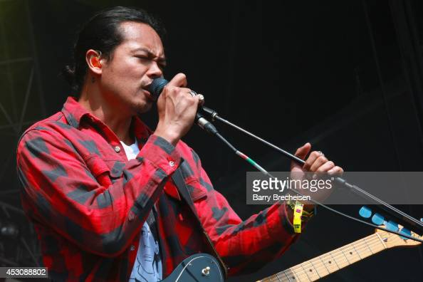 Dougy Mandagi of The Temper Trap performs at the Lake Shore stage during 2014 Lollapalooza Day Two at Grant Park on August 2 2014 in Chicago Illinois