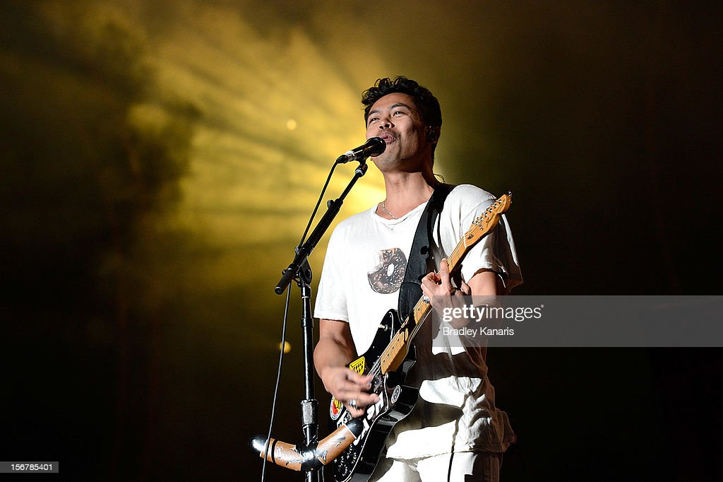 <a gi-track='captionPersonalityLinkClicked' href=/galleries/search?phrase=Dougy+Mandagi&family=editorial&specificpeople=5833212 ng-click='$event.stopPropagation()'>Dougy Mandagi</a> of the Temper Trap performs live for fans ahead of the Coldplay show at Suncorp Stadium on November 21, 2012 in Brisbane, Australia.