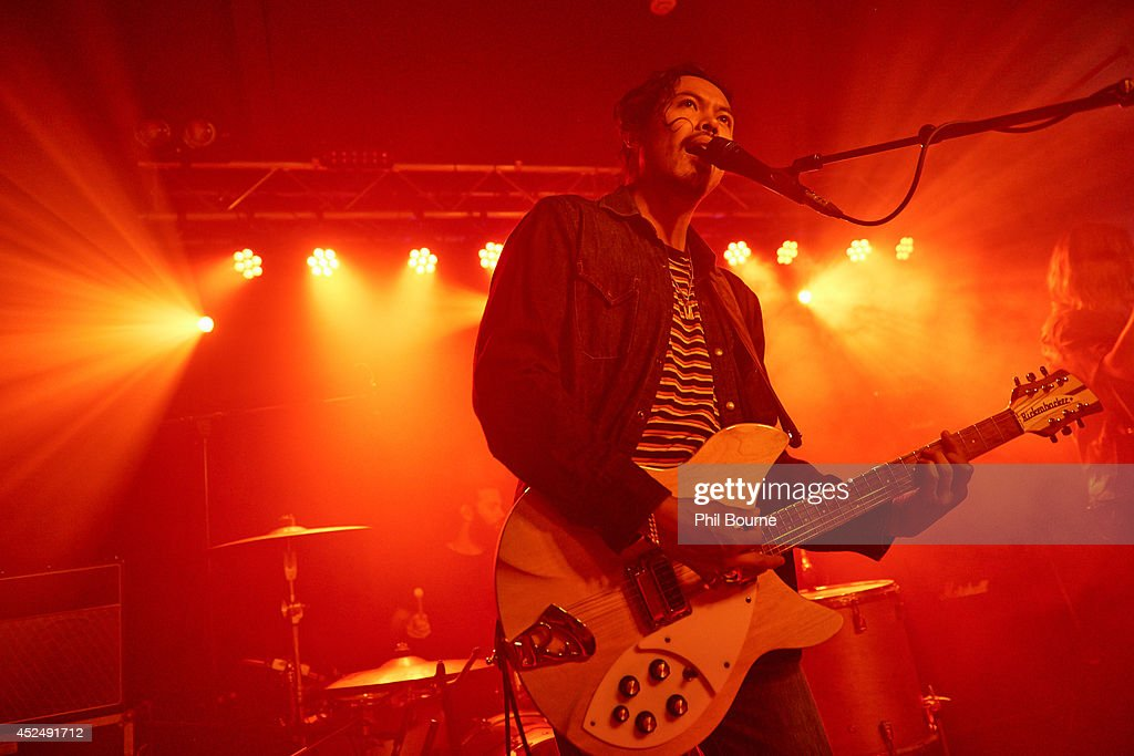 Dougy Mandagi of The Temper Trap performs on stage at Oslo on July 21 2014 in London United Kingdom