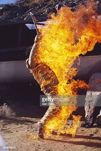 Doused in fuel from a gasoline tanker crash a Mexican drug dealer goes up in flames in a fight scene from the James Bond 007 movie 'Licence to Kill'...