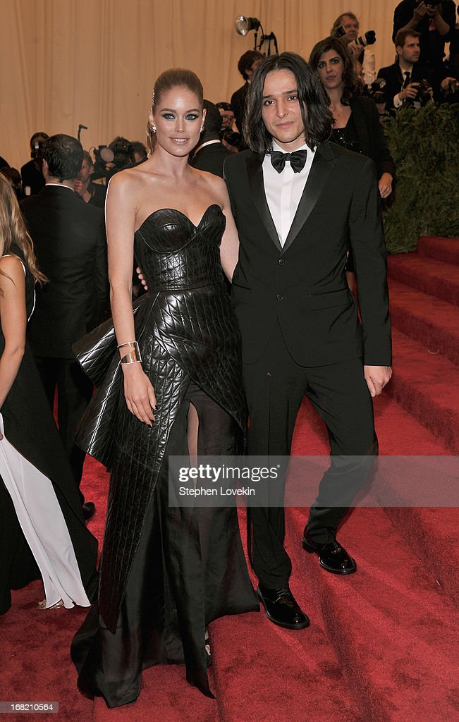 Doutzen Kroes and designer Olivier Theyskens attend the Costume Institute Gala for the 'PUNK: Chaos to Couture' exhibition at the Metropolitan Museum of Art on May 6, 2013 in New York City.