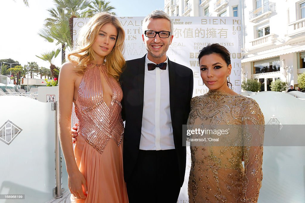 Doutzen Kroes (L) and Eva Longoria (R) attend the cocktail reception for L'Oreal during The 66th Annual Cannes Film Festival on May 17, 2013 in Cannes, France.