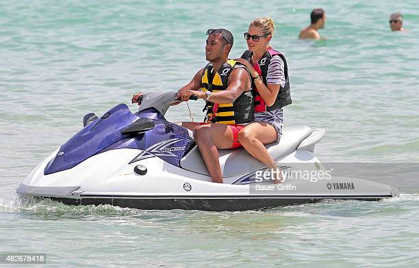 Doutzen Kroes and her husband DJ Sunnery James are seen riding on a jet ski on August 16 2012 in Miami Florida