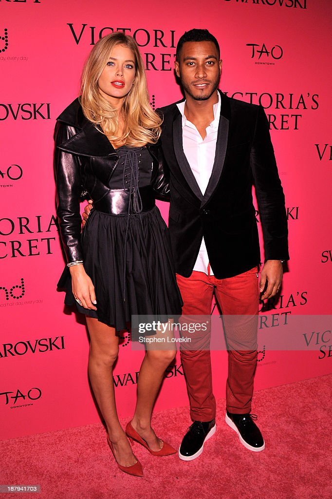 Doutzen Kroes and Sunnery James attend the 2013 Victoria's Secret Fashion Show at TAO Downtown on November 13, 2013 in New York City.