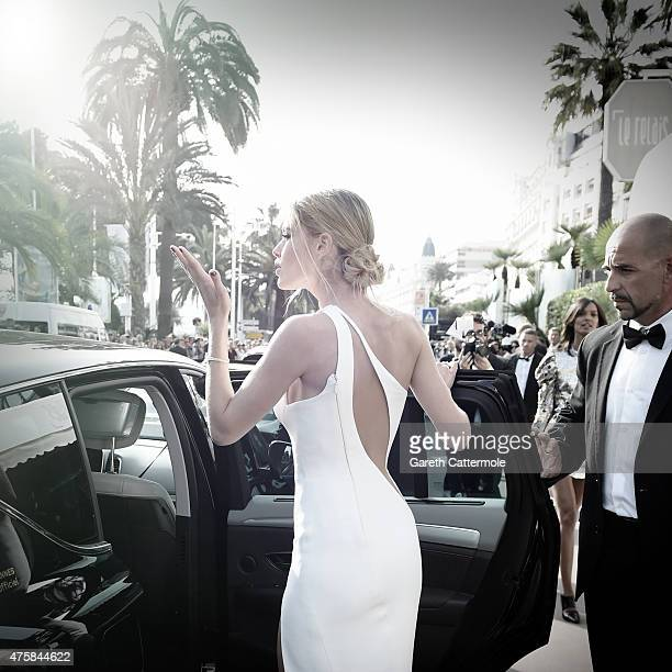 Doutzen Kroes departs the Martinez Hotel during the 68th annual Cannes Film Festival on May 13 2015 in Cannes France