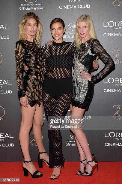 Doutzen Kroes Irina Shayk and Lara Stone attend the Gala 20th Birthday Of L'Oreal In Cannes during the 70th annual Cannes Film Festival at Martinez...