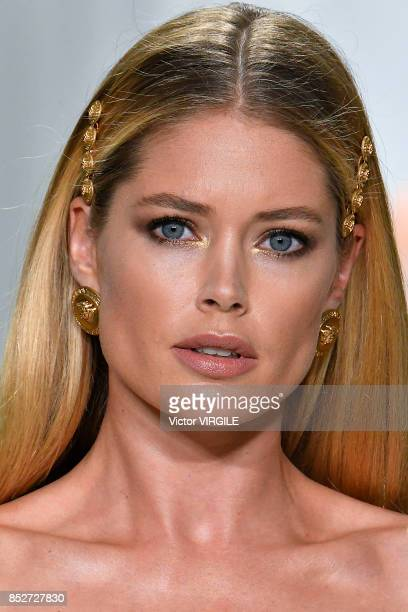 Doutzen Kroes walks the runway at the Versace Ready to Wear Spring/Summer 2018 fashion show during Milan Fashion Week Spring/Summer 2018 on September...
