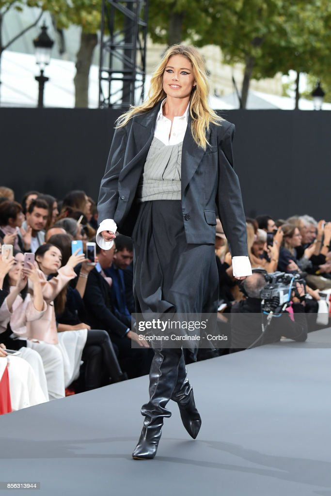 Doutzen Kroes walks the runway during the Le Defile L'Oreal Paris Spring Summer 2018 show as part of Paris Fashion Week at Avenue des Champs-Elysees on October 1, 2017 in Paris, France.
