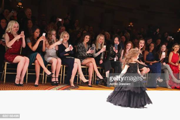 Dove Cameron Bethany Mota Brec Bassinger Jordyn Jones and Danielle Campbell watch as Taylen Biggs walks the runway at the Sherri Hill NYFW Fall 2017...