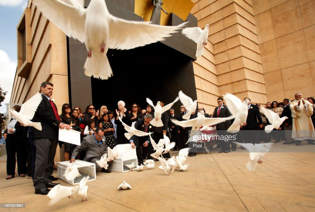 Doves are released by family at the conclusion of the funeral mass for former teacher Sal Castro at the Cathedral of Our Lady of Angels on April 25, 2013 in Los Angeles, California. Sal Castro was one of the leaders of the 1968 Chicano student walkouts, a protest for better schools that is considered the start of the Chicano movement.