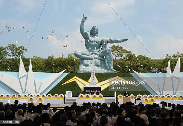 Doves fly over the Peace Statue during a memorial ceremony to mark the 70th anniversary of the atomic bombing of Nagasaki on August 9 2015 Japan on...