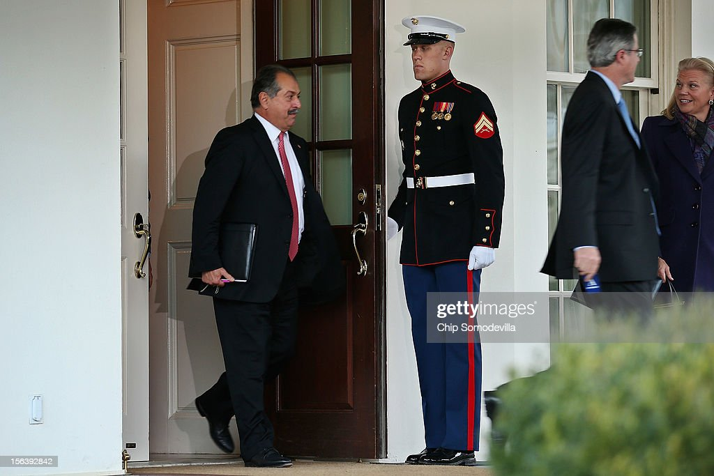Dow Chemical Company President, Chairman and CEO Andrew Liveris (L) leaves the West Wing after attending a meeting with President Barack Obama and other business leaders at the White House November 14, 2012 in Washington, DC. According to the White House, Obama is holding a series of meetings this week with business, labor and political leaders to discuss ways to continue to improve the economy and reduce the deficit.