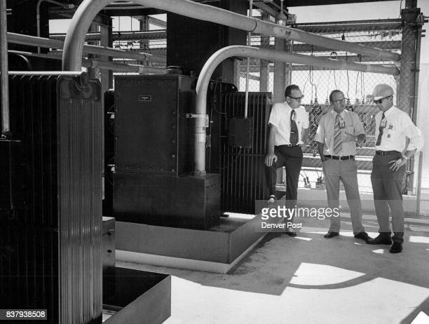 Dow Employees Discuss Work Done In Diking These Transformers From left are Robert V Carroll director of public information William Lee fabrication...
