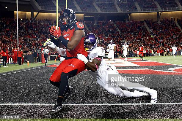 Dowdy of the Cincinnati Bearcats catches a pass for a touchdown while being defended by Terrell Richardson of the East Carolina Pirates during the...
