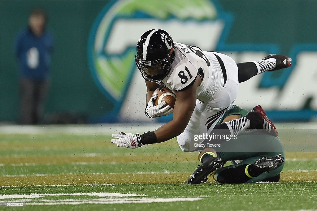 DJ Dowdy #81 of the Cincinnati Bearcats is brought down by Parry Nickerson #17 of the Tulane Green Wave during the fourth quarter of a game at Yulman Stadium on October 31, 2014 in New Orleans, Louisiana.