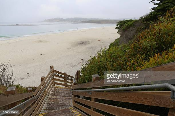 Down a wooden staircase to the Carmel Beach