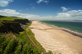 well known beach in northern ireland on a sunny day