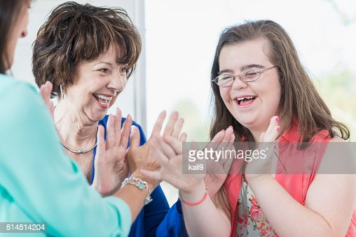 Down syndrome girl with family playing games