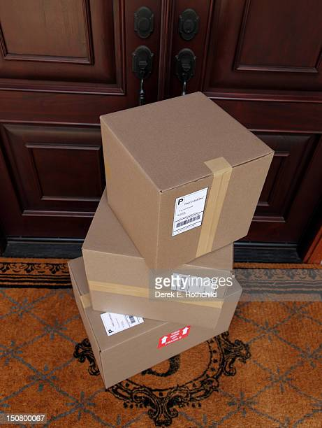 Down view of packages stacked by double doors