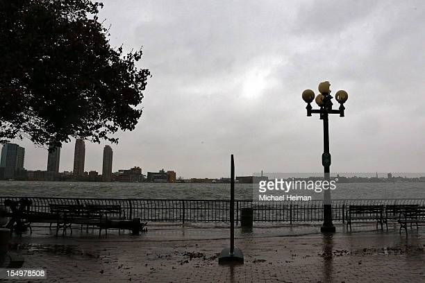 A downed light pole in seen along the overflowing banks of the East River ahead of Hurricane Sandy October 29 2012 on eastside of Manhattan in New...
