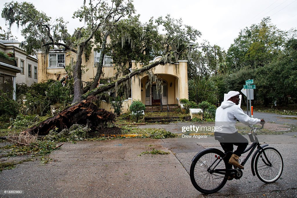 A downed tree from Hurricane Matthew rests against a home October 8 2016 in Savannah Georgia Across the Southeast Over 14 million people have lost...