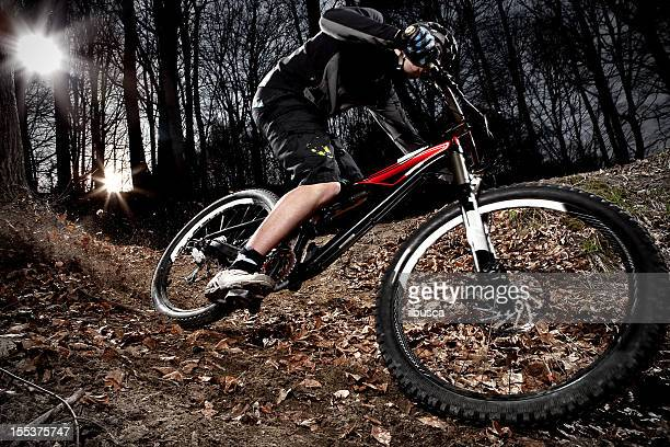 Downhill enduro mountain bike curve in the woods
