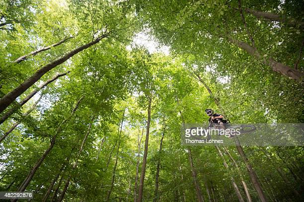 A downhill mountain biker performs at the so called 'Rinne' at the mountain 'Frankenstein' on July 29 2015 near Darmstadt Germany The 'Rinne' is...