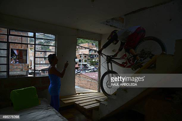 A downhill rider competes during the Adrenalina Urban Bike race final at the Comuna 13 shantytown in Medellin Antioquia department Colombia on...