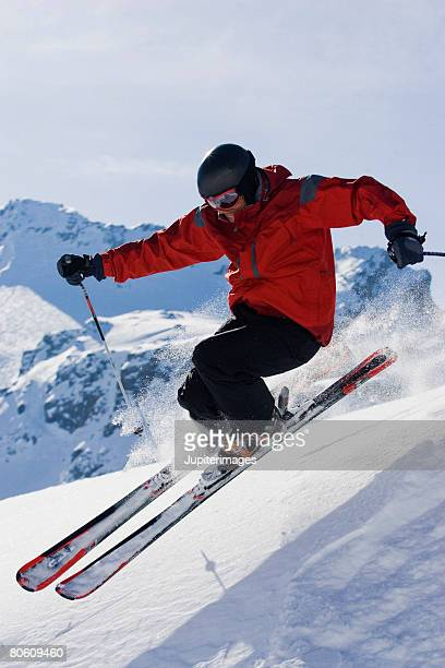 Downhill skier in mid-air