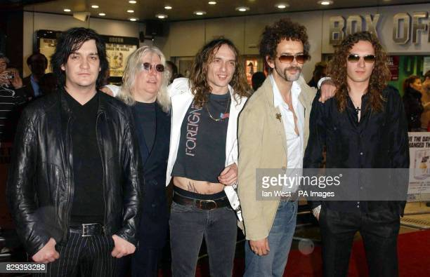 KK Downing from the group Judas Priest with The Darkness arrive for the premiere of the Live Aid DVD held at the Odeon Kensington in London