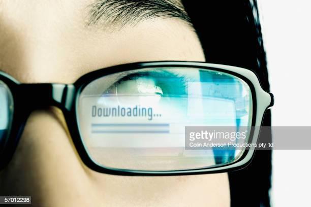 Downloading reflection in eyeglass lens